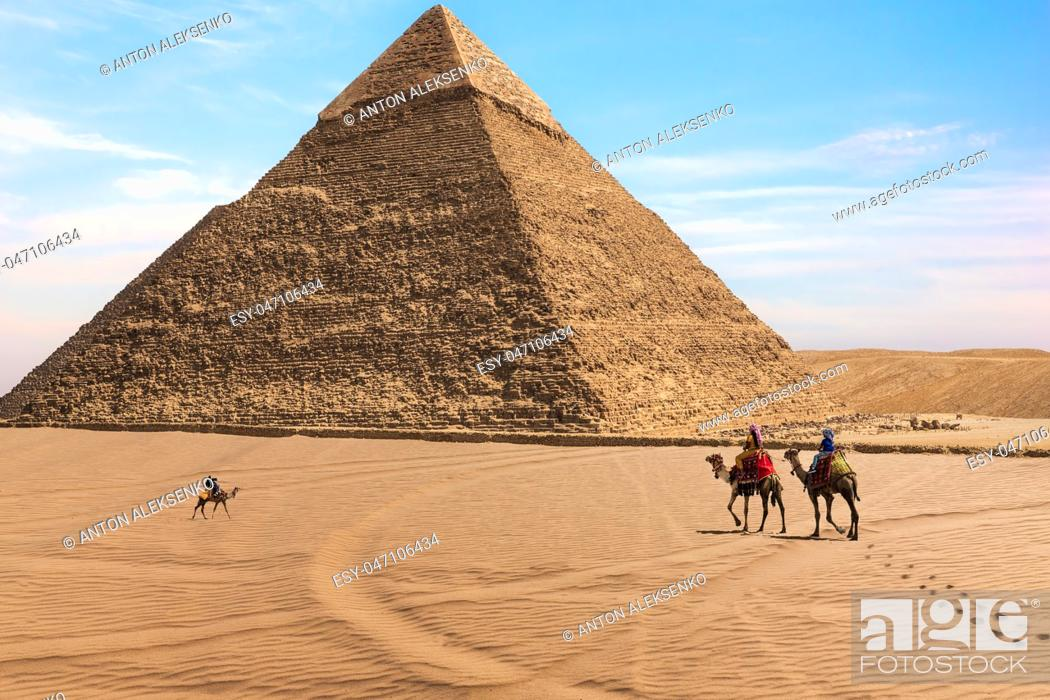 Stock Photo: The Pyramid of Chephren and bedouins in the desert of Giza, Egypt.