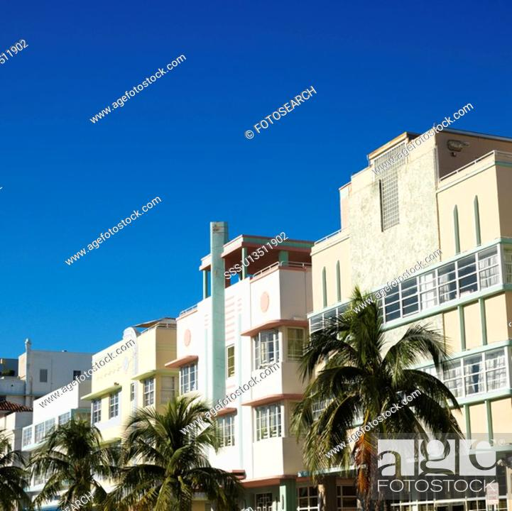 Stock Photo: Palm trees and buildings in art deco district of Miami, Florida, USA.