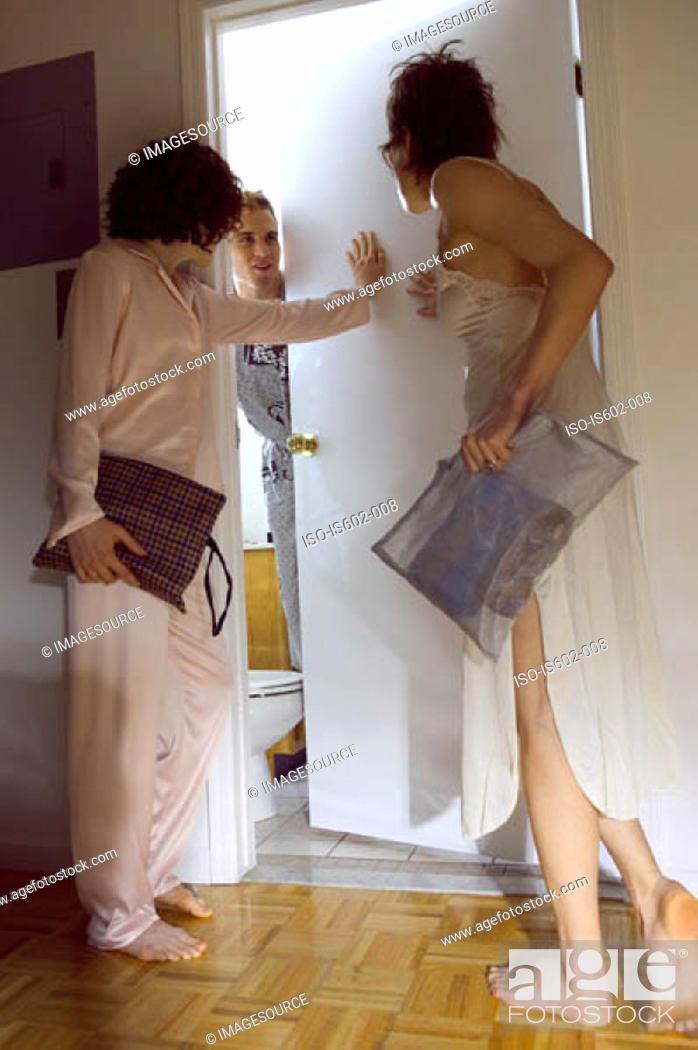 Stock Photo: Women at man's bedroom door.