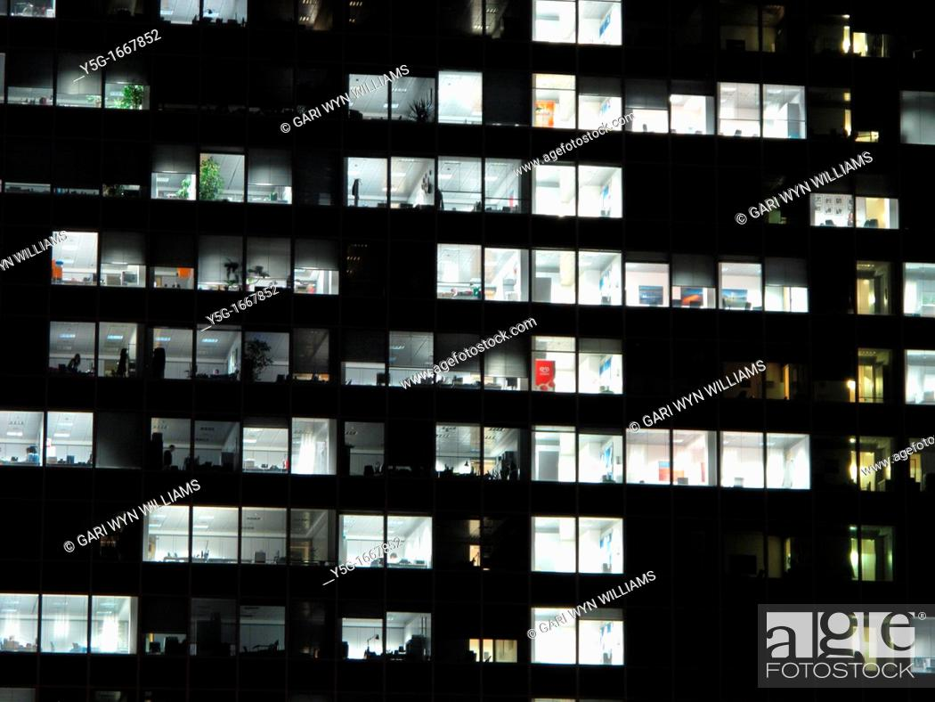 Stock Photo: high rise office block in city at night.
