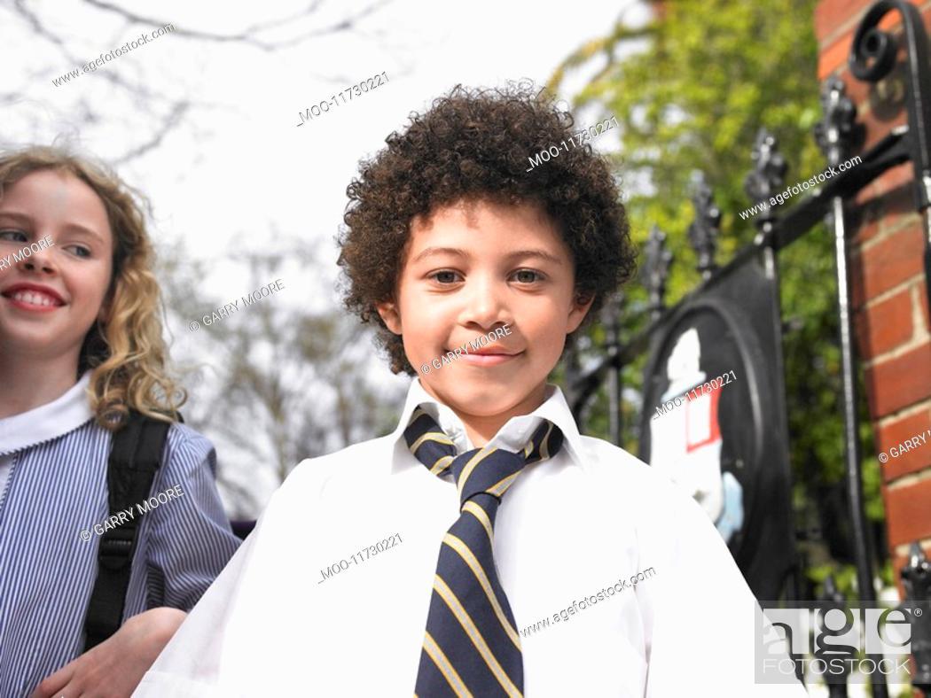 Stock Photo: Elementary school students standing by school gate portrait.