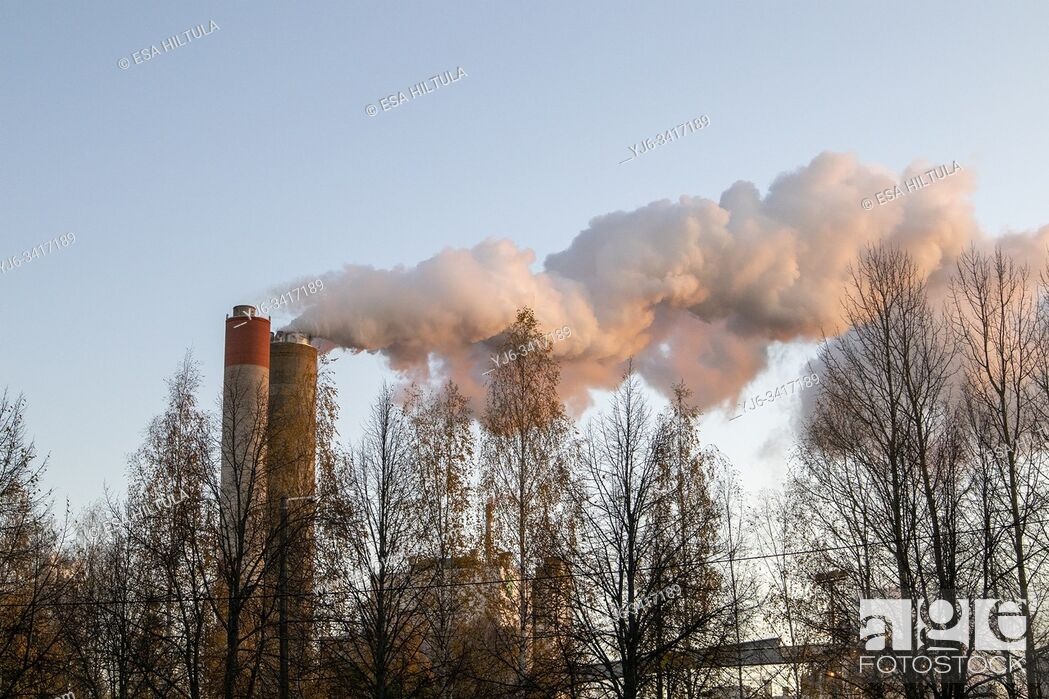 Stock Photo: Smoke billowing from a pulp and paper factory, Finland.