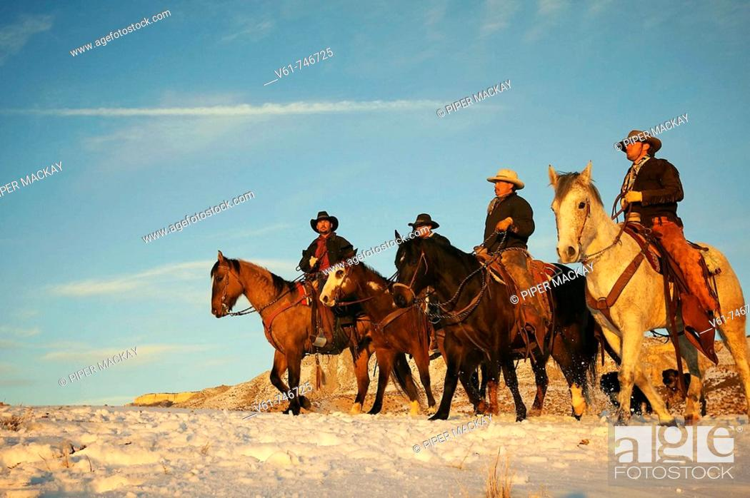 Stock Photo: Wranglers out for a ride in the snow, Shell, Wyoming, USA.