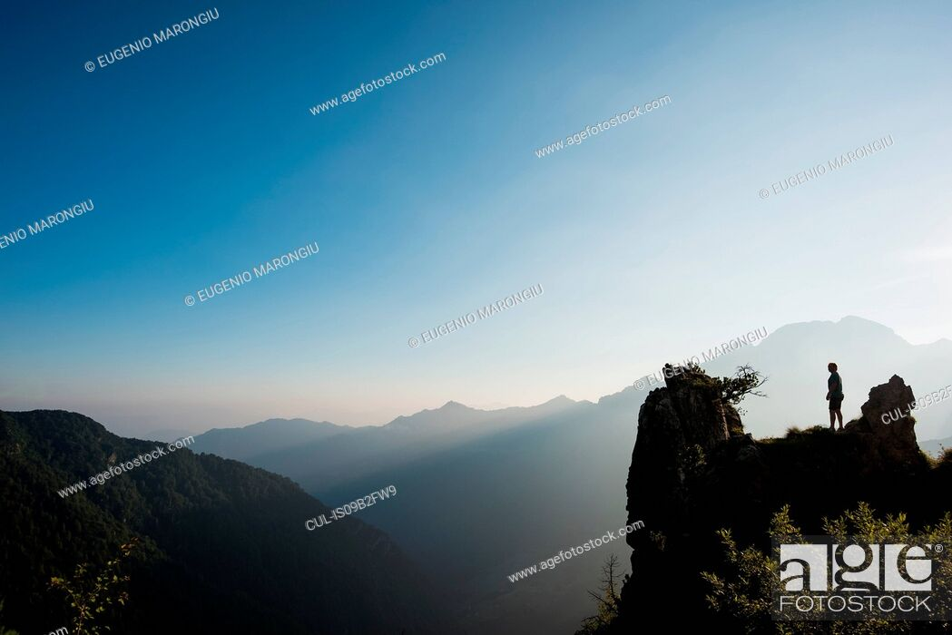 Stock Photo: Silhouette of distant man on mountain peak, Passo Maniva, Italy.