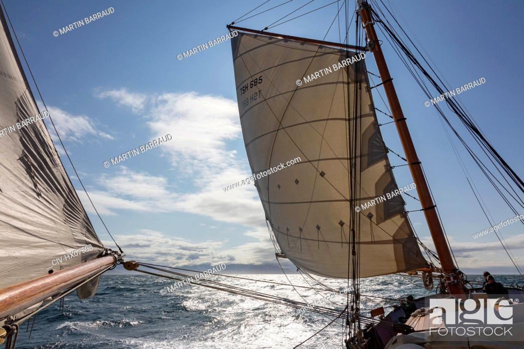 Stock Photo: Sailboat sails blowing in wind over sunny Atlantic Ocean Greenland.