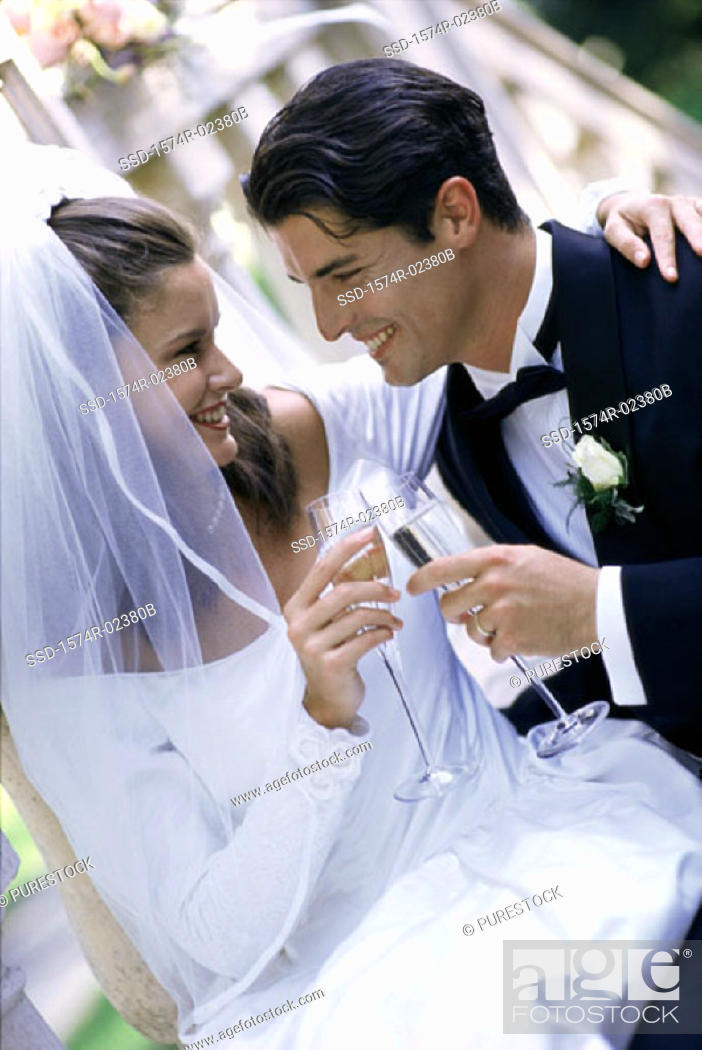 Stock Photo: Newlywed couple toasting with glasses of champagne.