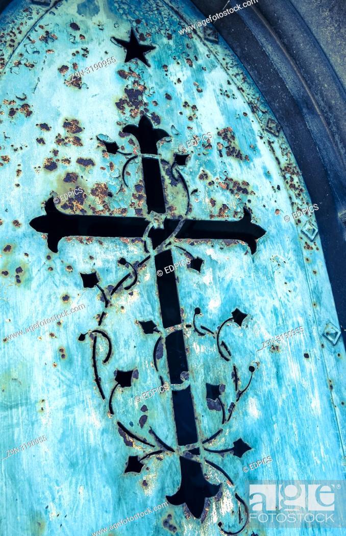 Stock Photo: historic metal door showing a cross and floral ornaments, paris, ile de france, france.