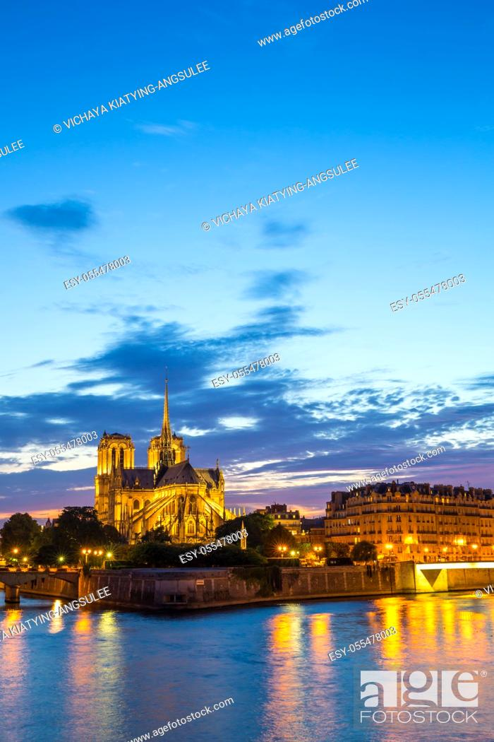 Stock Photo: Notre Dame Cathedral at dusk in Paris, France.