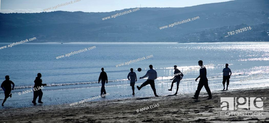 Stock Photo: Boys playing football on the beach in Tangier, Morocco, Africa.