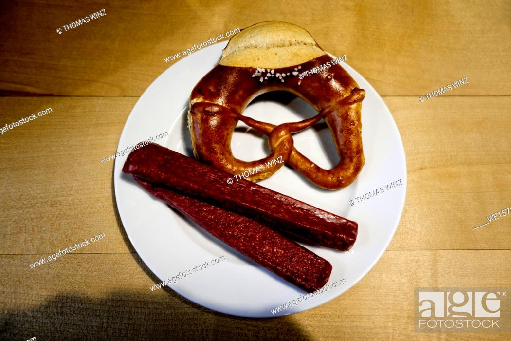 Stock Photo: Soft Pretzel and dried smoked sausage ( Landjäger) , Southern Germany.