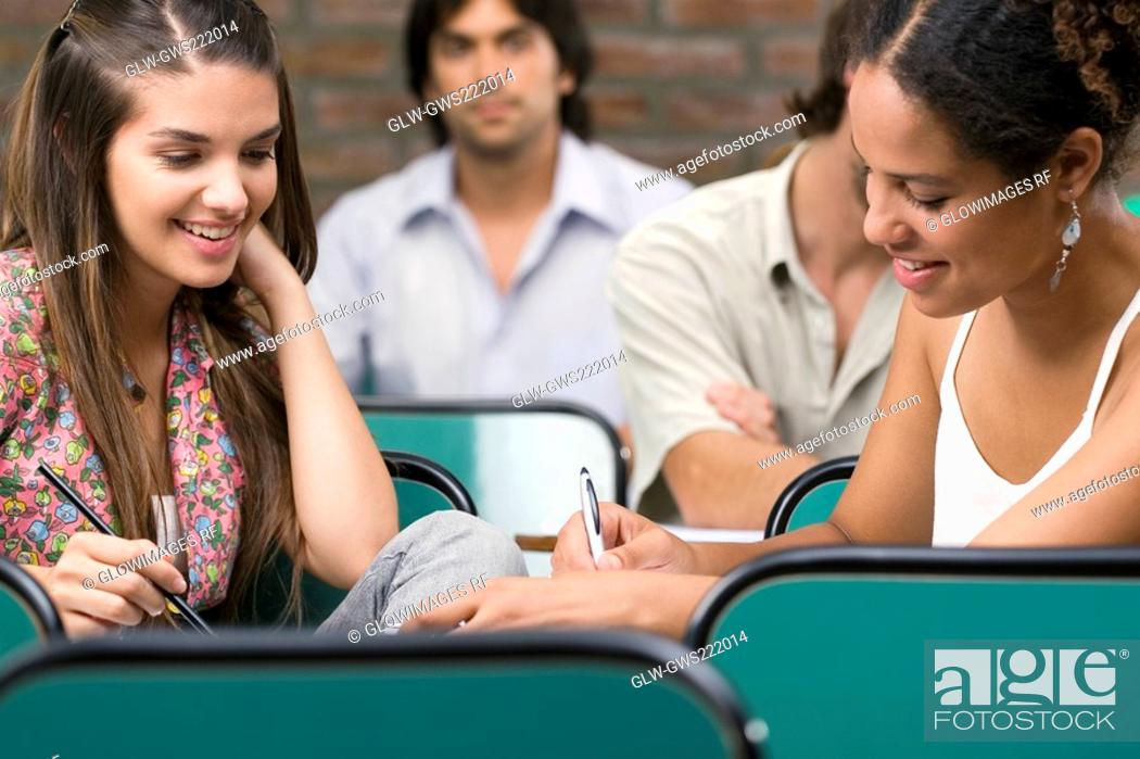 Stock Photo: University students studying in a classroom.