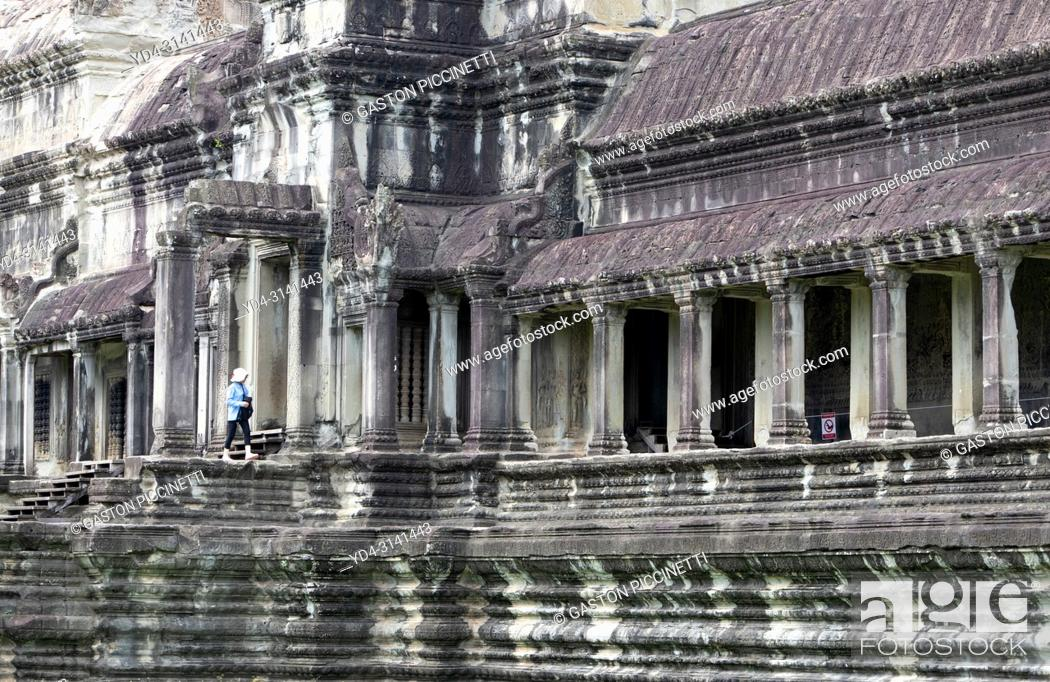 Stock Photo: Tourist in Angkor Wat Temple, Angkor Temple Complex, Siem Reap Province, Cambodia, Asia, UNESCO. It was originally constructed as a Hindu temple dedicated to.