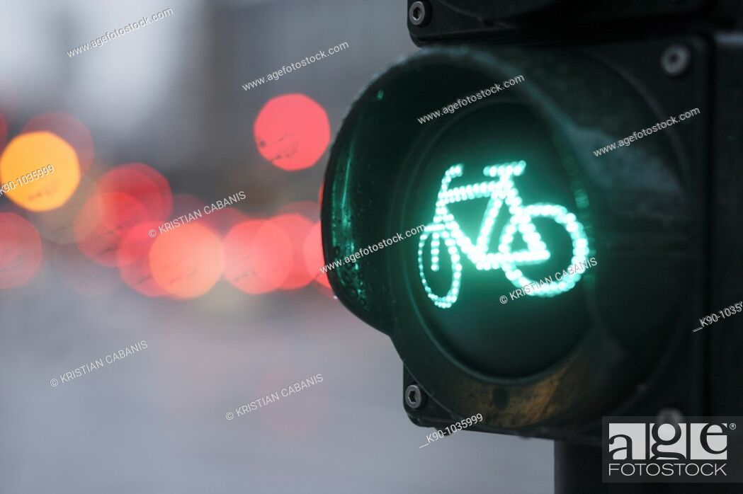 Stock Photo: Close-up of traffic light for bicyclists, showing green light at an intersection with blurred background, Hamburg, Germany, Europe.