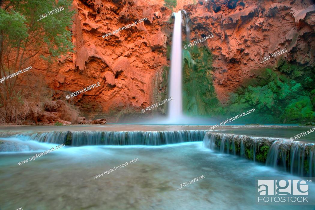Stock Photo: Low angle view in the Grand Canyon as Mooney Falls drop into turquoise pool, USA, Arizonal.