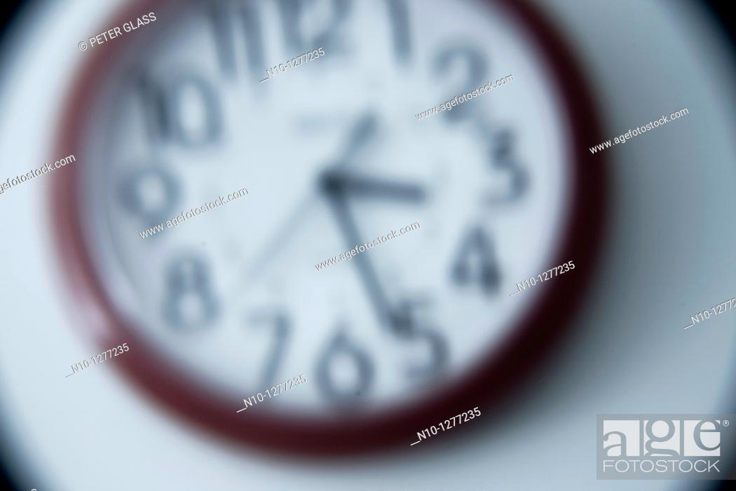 Stock Photo: Red wall clock.