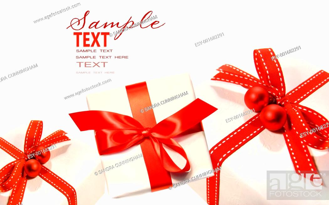 Stock Photo: Gifts wrapped with red ribbons isolated on white.