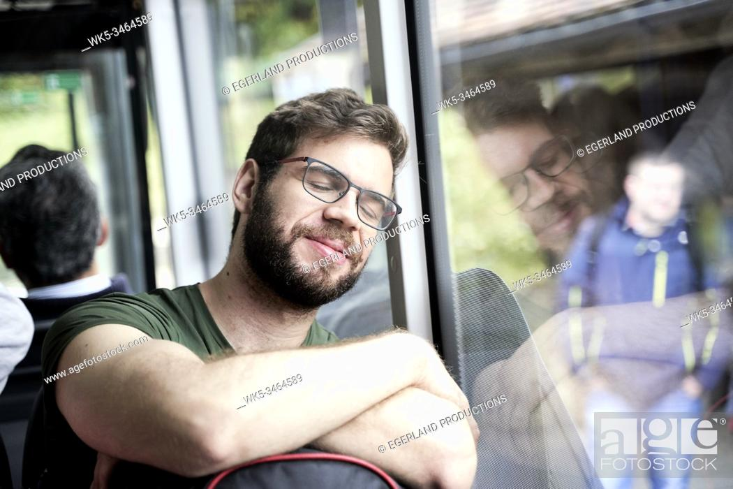 Stock Photo: Man travelling in train. Eibsee, Bavaria, Germany.