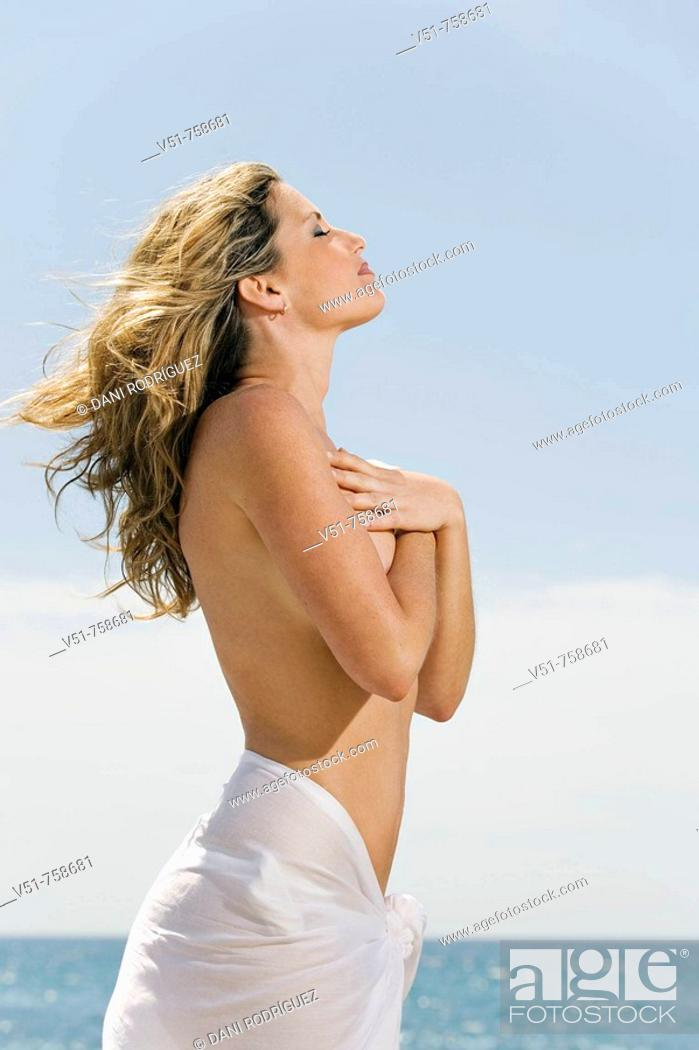 Stock Photo: Woman breathing by the sea.