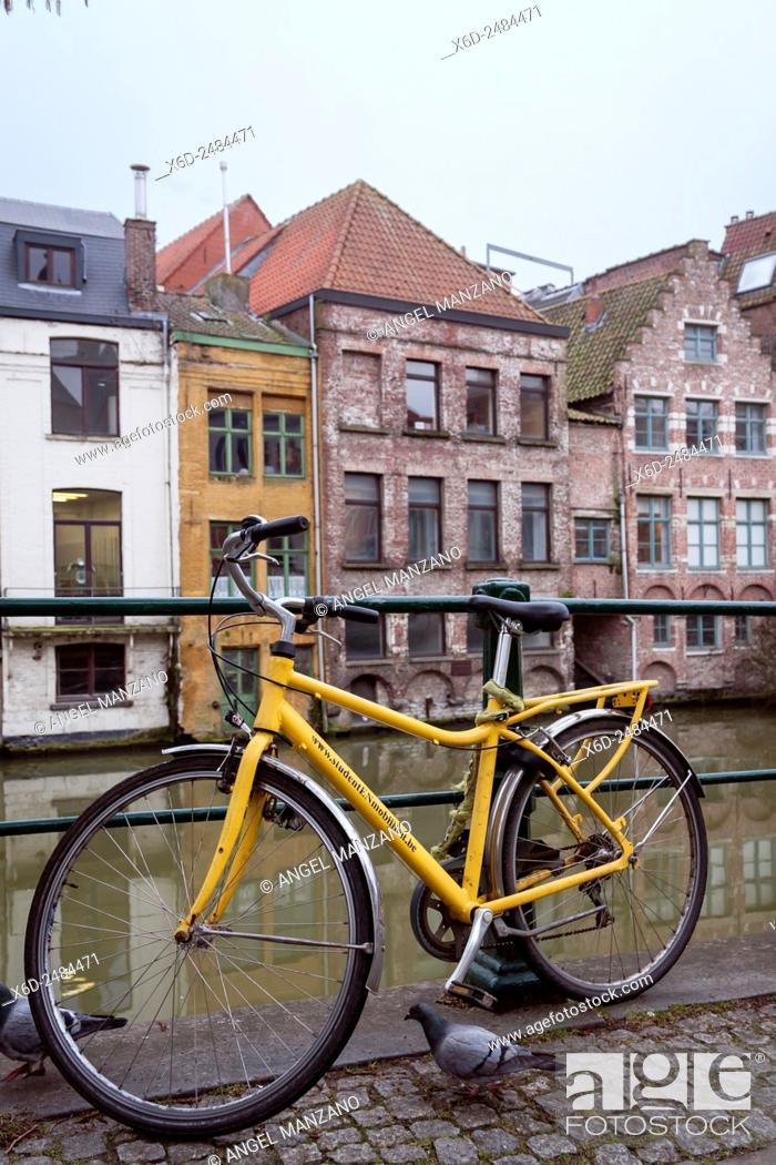 Stock Photo: Bicycle in old town canal, Gent.