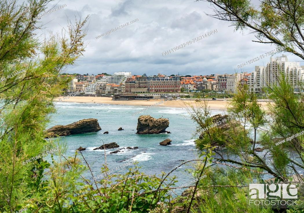 Stock Photo: 21 June 2019, France (France), Biarritz: The Hotel du Palais (M) on the beach of Biarritz. The upcoming G7 summit will take place here from 24.08.