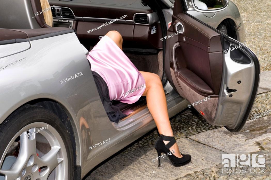Stock Photo: Leg and Porsche.