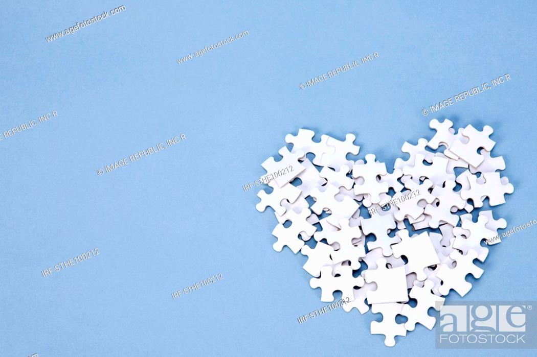 Stock Photo: heart shape made by pieces of puzzle.