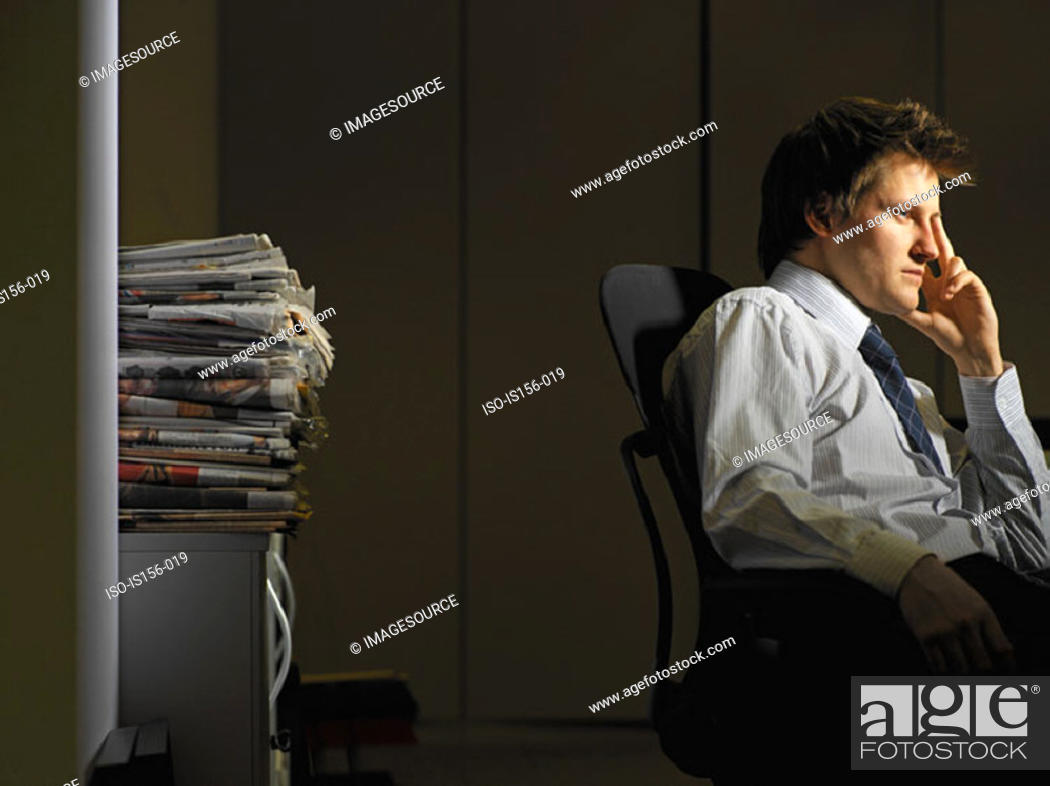 Stock Photo: Bored man in his office.
