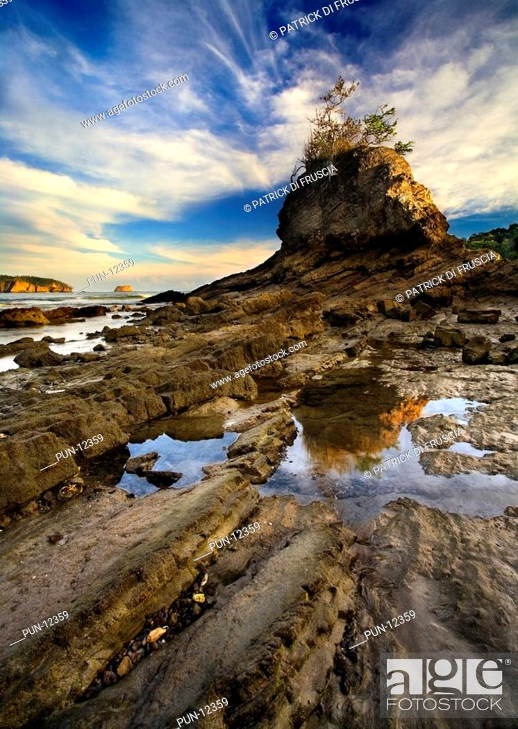 Stock Photo: Dramatic impression of great rock patterns with reflection, Costa Rica.