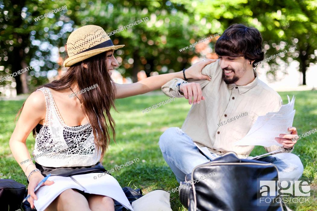 Stock Photo: Two students having fun in a park.