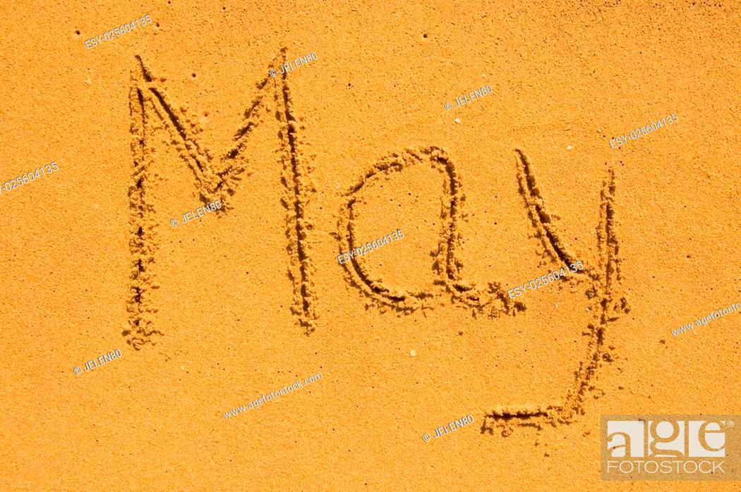 Stock Photo: Month May in the sand.