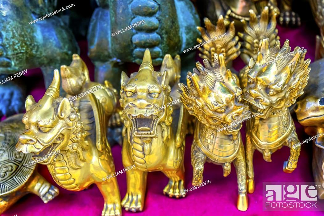 Stock Photo: Chinese Replica Bronze Dragons Panjuan Flea Market Decorations Beijing China. Panjuan Flea Curio market has many fakes, replicas and copies of older Chinese.
