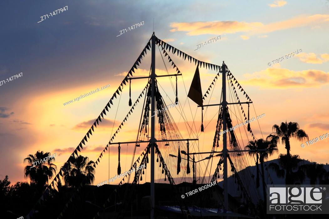 Stock Photo: Turkey, Alanya, sunset sky, ships's masts, palms,.