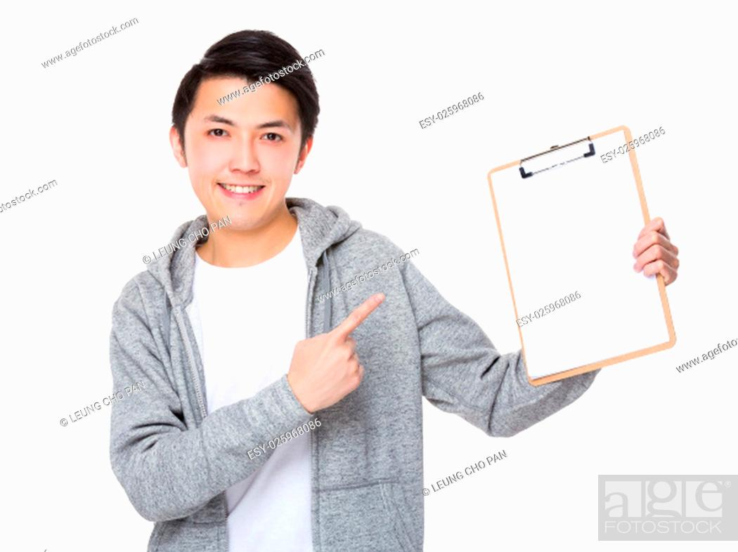 Stock Photo: Man finger point to clipboard.