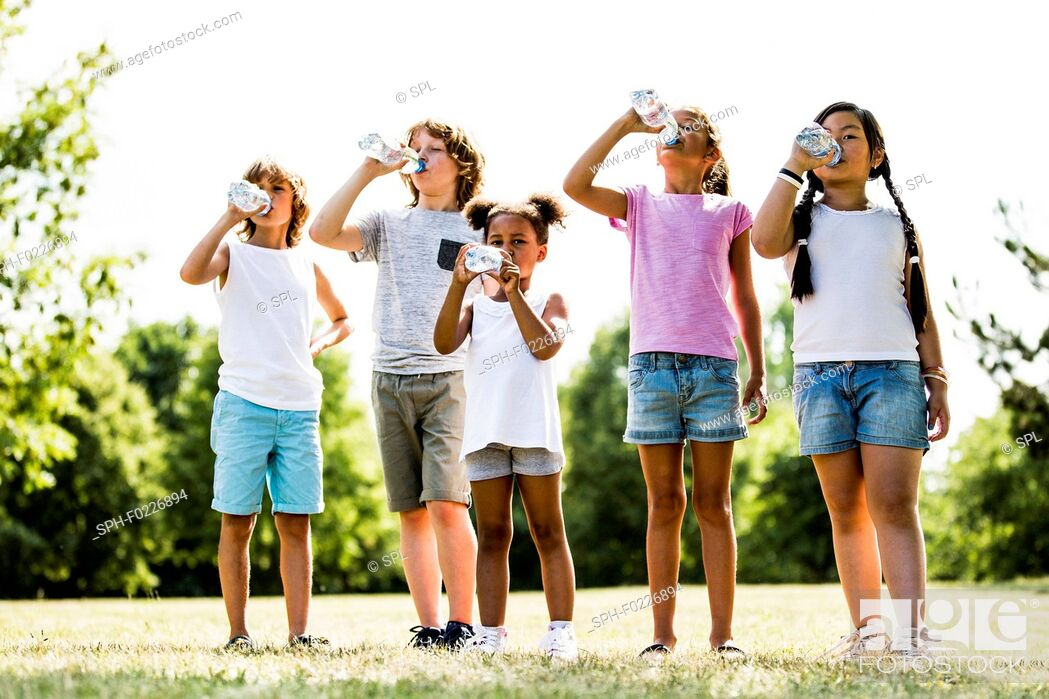 Stock Photo: Children drinking water.