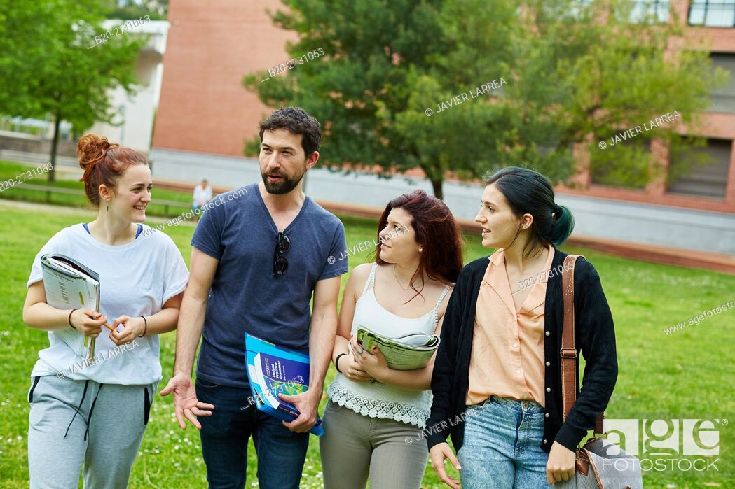 Stock Photo: Students walking on campus lawn.