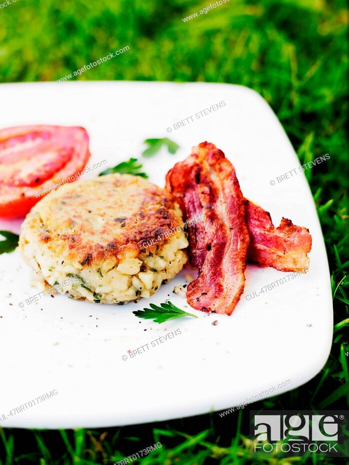 Stock Photo: Plate of bacon with biscuit and tomato.