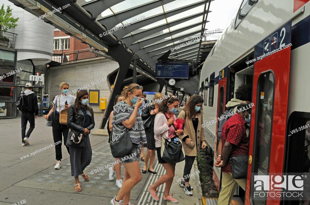 Stock Photo: Zürich/Switzerland: Face masks are mandatory now on public transport in Switzerland like here in Zürich City.