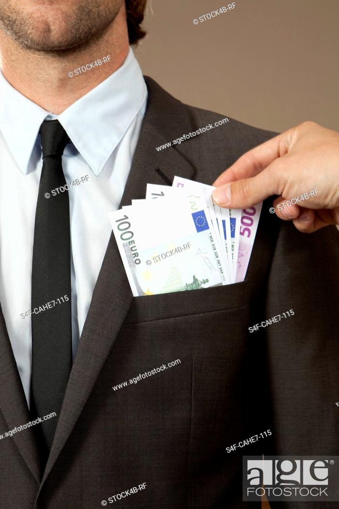Stock Photo: Hand grasping in jacket pocket with Euro notes.
