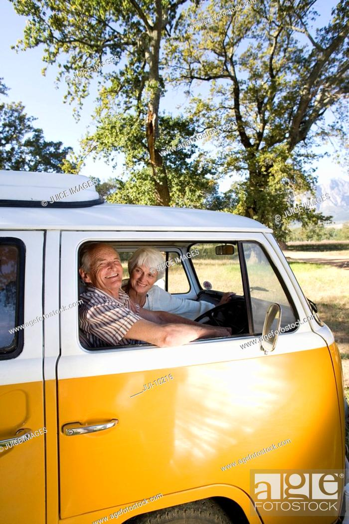 Stock Photo: Senior couple in camper van, smiling, portrait of man.