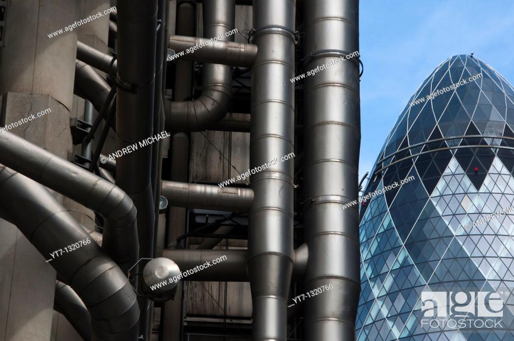 Stock Photo: Lloyds of London and the Gherkin buildings in London's financial district  England.