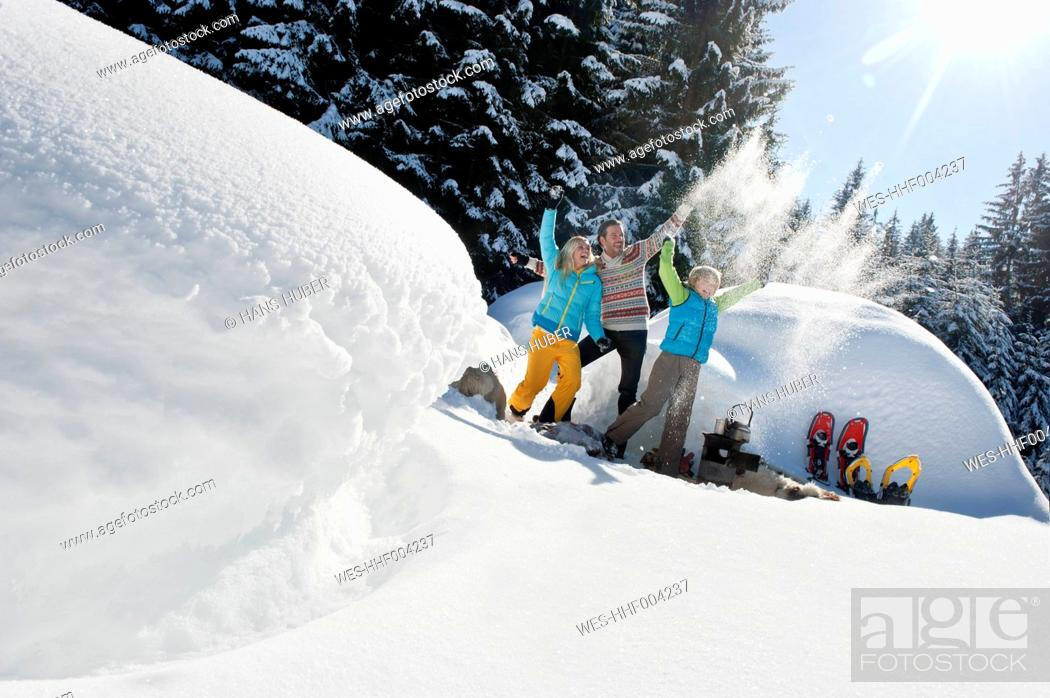 Stock Photo: Austria, Salzburg County, Family standing near igloo.