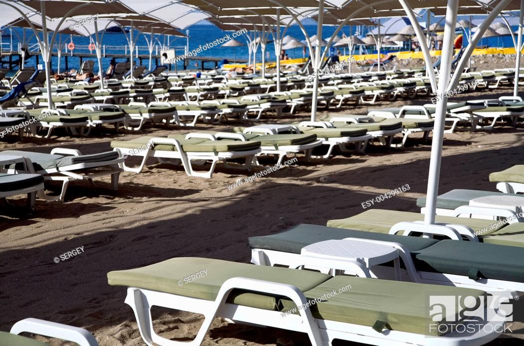 Stock Photo: empty deck chairs on an uninhabited tropical beach.