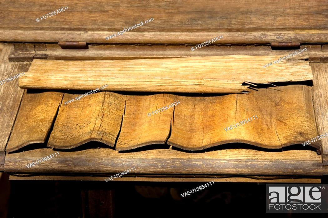 Stock Photo: Pieces of weathered wood on shelf.