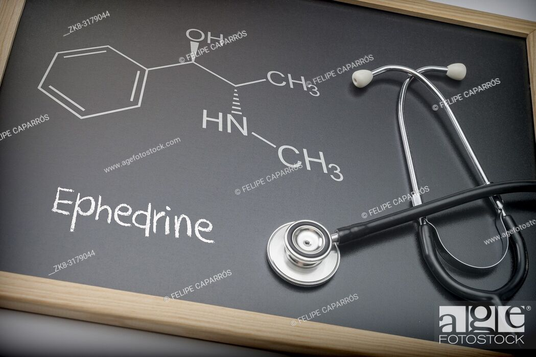 Stock Photo: Word thyroid written in chalk on a blackboard black next to a stethoscope, conceptual image.