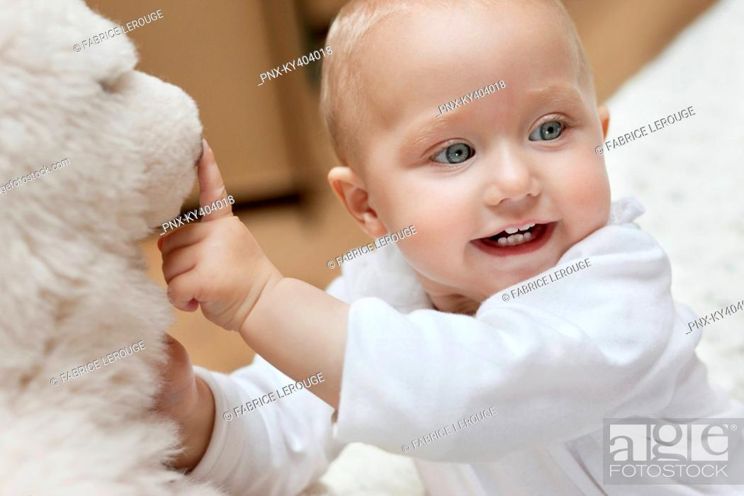 Stock Photo: Baby girl playing with a toy.