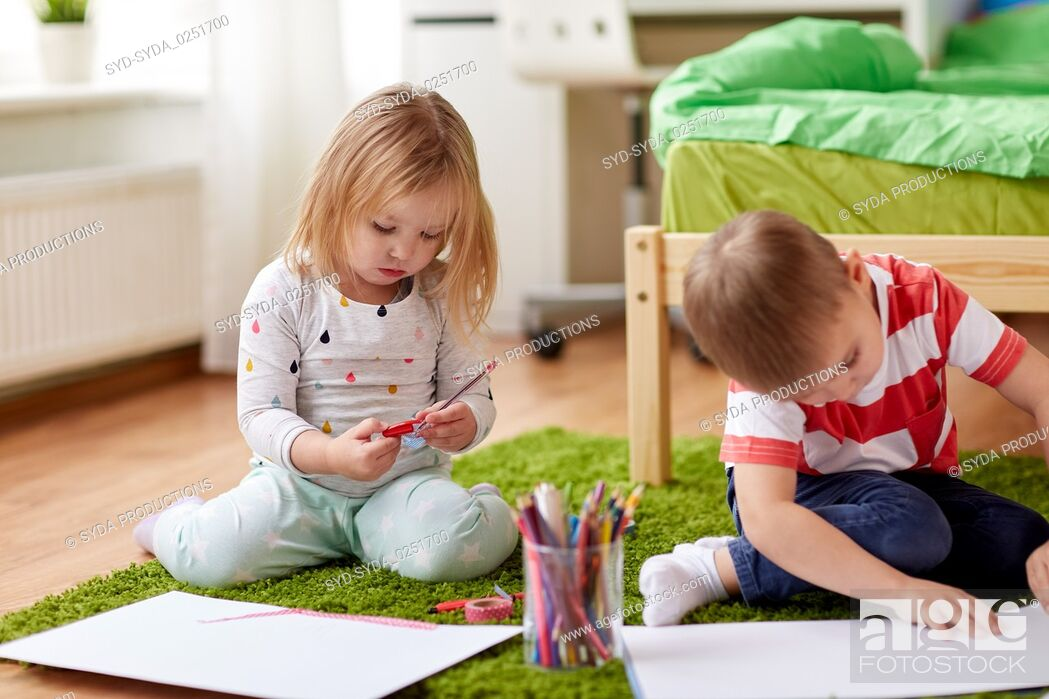 Stock Photo: happy kids drawing at home.