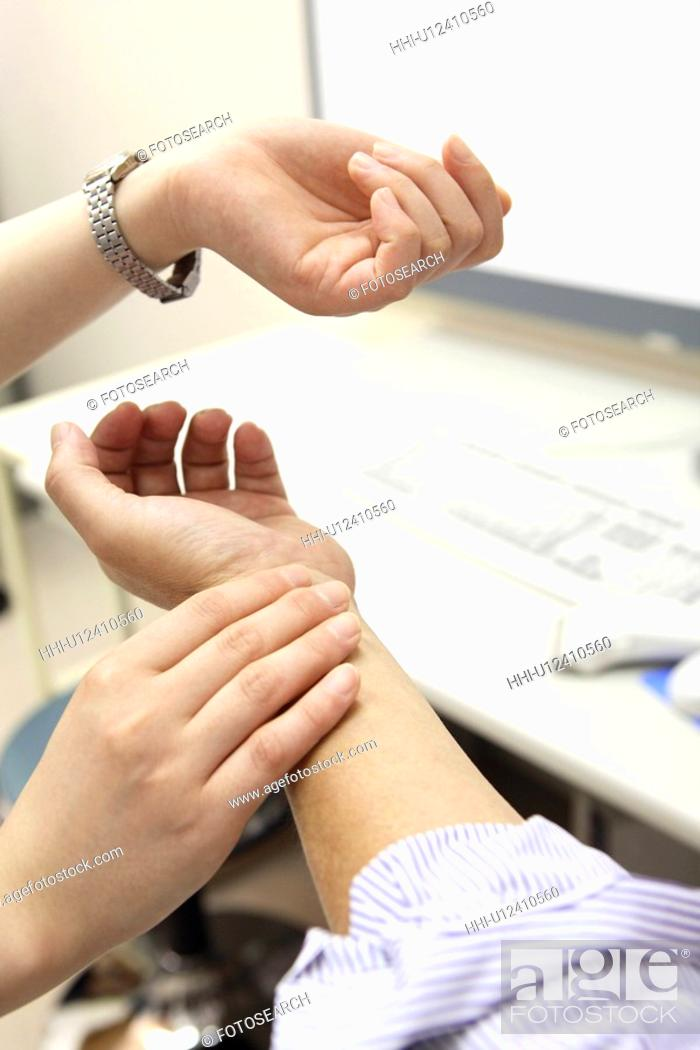 Stock Photo: Hand measuring a pulse.