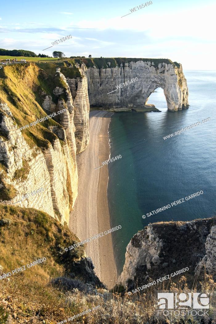 Stock Photo: Four people enjoying the views of the Cliffs of Etretat, Normandy, France.