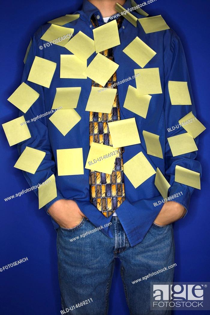 Stock Photo: Portrait of boy covered with sticky notes.