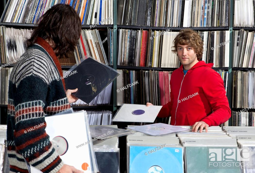 Stock Photo: Two men shopping in a record store.